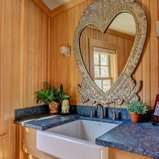 На фото: туалет среднего размера в стиле современная классика с фасадами с декоративным кантом, фасадами цвета дерева среднего тона, коричневыми стенами, полом из керамической плитки, врезной раковиной, столешницей из талькохлорита, серым полом и серой столешницей