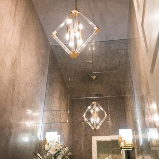 Idée de décoration pour un WC et toilettes design de taille moyenne avec un placard à porte plane, des portes de placard blanches, un WC à poser, des carreaux de miroir, un mur gris, un sol en marbre, une vasque, un plan de toilette en quartz modifié, un sol beige et un plan de toilette marron.