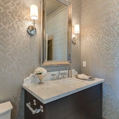 Example of a mid-sized classic white tile porcelain tile powder room design in Vancouver with an undermount sink, flat-panel cabinets, dark wood cabinets, granite countertops, gray walls and white countertops