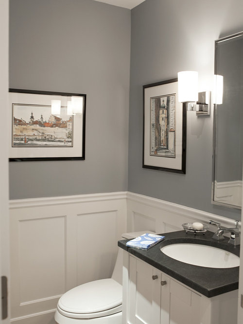 ... cabinets, white cabinets, soapstone countertops and a one-piece toilet