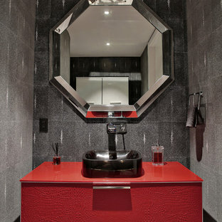 Example of a large trendy gray tile porcelain floor powder room design in Miami with an undermount sink, flat-panel cabinets, red cabinets and gray walls