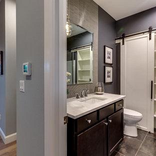 Идея дизайна: туалет среднего размера в стиле современная классика с фасадами в стиле шейкер, темными деревянными фасадами, раздельным унитазом, разноцветной плиткой, стеклянной плиткой, серыми стенами, полом из керамической плитки, врезной раковиной, столешницей из искусственного кварца и черным полом