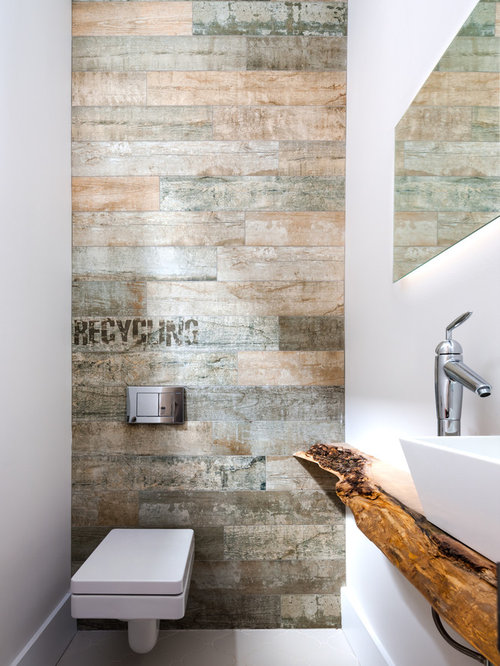powder room idea in toronto with a vessel sink wood countertops a wall