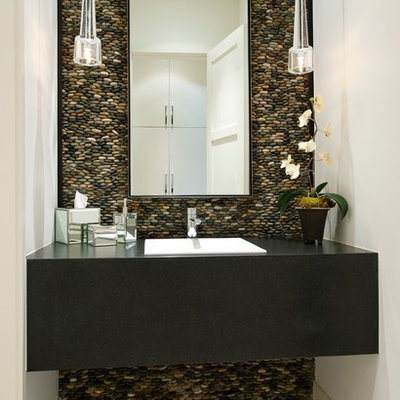 Inspiration for a contemporary pebble tile and gray tile powder room remodel in Dallas with a drop-in sink