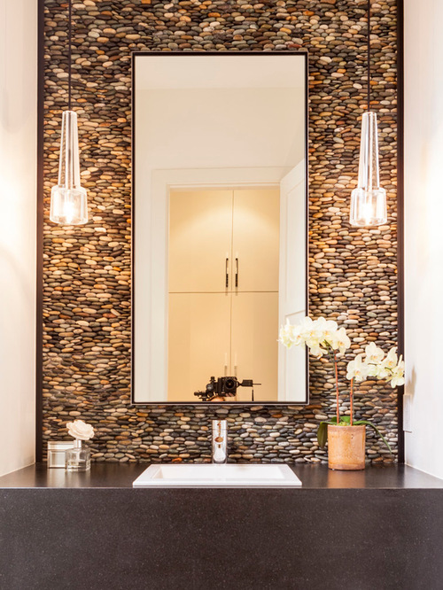 Rock Wall Design river rock wall 900x1315 white apartment in kiev makes a case for monochromatic design River Rock Accent Wall