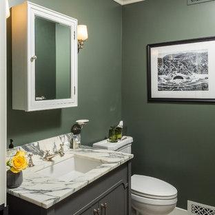 Exemple d'un petit WC et toilettes chic avec un placard en trompe-l'oeil, des portes de placard grises, un WC séparé, un mur gris, un sol en carreaux de ciment, un lavabo encastré, un plan de toilette en marbre, un sol gris et un plan de toilette multicolore.