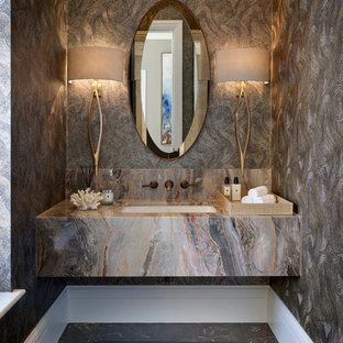 Mid-sized contemporary powder room in Berkshire with marble floors, an undermount sink and black floor.