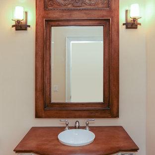 Esempio di un bagno di servizio chic di medie dimensioni con consolle stile comò, ante bianche, lavabo a bacinella e top in cemento