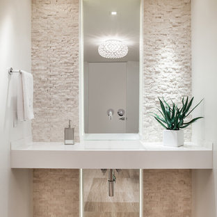 This is an example of a small contemporary cloakroom in Miami with an integrated sink, white walls, light hardwood flooring, open cabinets, white cabinets, a two-piece toilet, beige tiles, stone tiles, quartz worktops, beige floors and white worktops.