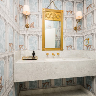 This is an example of a victorian powder room in Sydney with white cabinets and marble benchtops.