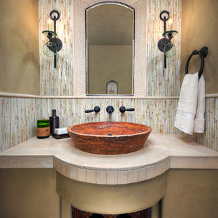 Photo of a small mediterranean cloakroom in Phoenix with beige walls, a vessel sink, travertine worktops, multi-coloured tiles and stone slabs.
