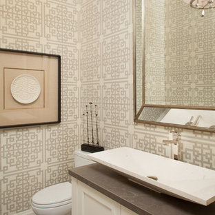 Photo of a small classic cloakroom in Miami with a one-piece toilet, multi-coloured tiles, ceramic flooring, recessed-panel cabinets, beige walls, a vessel sink, concrete worktops, white cabinets and grey worktops.