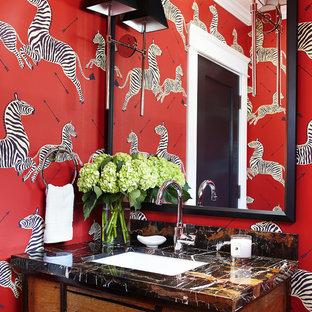 На фото: туалет среднего размера в стиле современная классика с врезной раковиной, фасадами островного типа, фасадами цвета дерева среднего тона, красными стенами и столешницей из оникса с