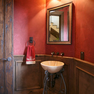 Example of a tuscan powder room design in Other with red walls