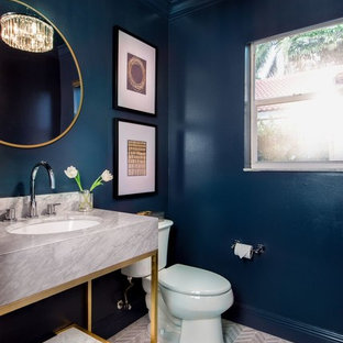 This is an example of a contemporary cloakroom in Miami with a two-piece toilet, multi-coloured tiles, mosaic tiles, blue walls, mosaic tile flooring, a submerged sink and marble worktops.