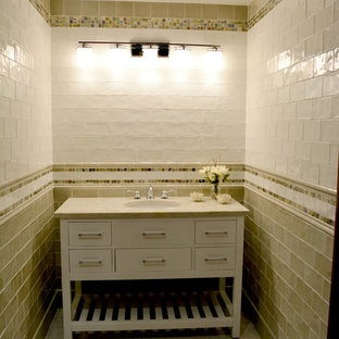 Inspiration for a small coastal cloakroom in DC Metro with flat-panel cabinets, white cabinets, beige tiles, multi-coloured tiles, white tiles, metro tiles, white walls, light hardwood flooring and granite worktops.