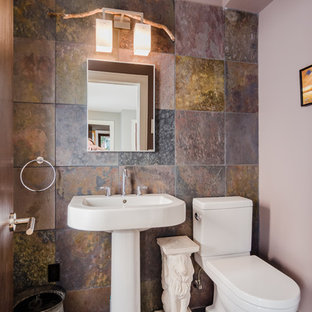 Inspiration for a small cloakroom in Boston with a one-piece toilet, grey tiles, grey walls, slate flooring, a pedestal sink, slate tiles and grey floors.