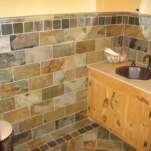 Design ideas for a medium sized rustic cloakroom in Atlanta with flat-panel cabinets, light wood cabinets, slate tiles, multi-coloured walls, slate flooring, a built-in sink and multi-coloured floors.