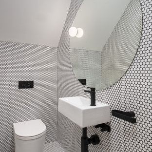 Contemporary powder room in Sydney with white tile, mosaic tile, mosaic tile floors, a wall-mount sink, white floor and vaulted.