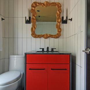 Неиссякаемый источник вдохновения для домашнего уюта: туалет в современном стиле с врезной раковиной, фасадами островного типа, красными фасадами, столешницей из гранита, унитазом-моноблоком, белой плиткой и керамогранитной плиткой