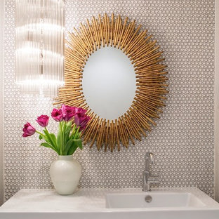 Photo of a midcentury powder room in Other with a wall-mount sink, white walls and mosaic tile.