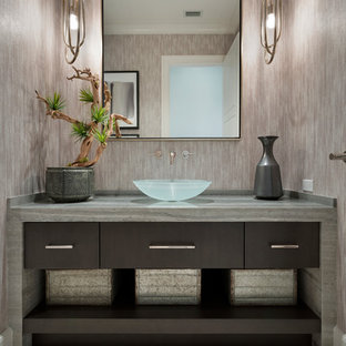 Design ideas for a traditional cloakroom in Miami with flat-panel cabinets, dark wood cabinets, grey walls, a vessel sink and beige floors.