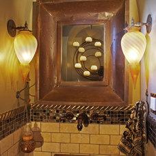 Mediterranean Powder Room by Vanguard Studio Inc.