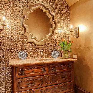 Photo of a mediterranean cloakroom in Dallas with a submerged sink, medium wood cabinets, multi-coloured tiles, brown walls and brown worktops.