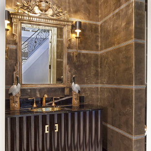 Inspiration for a small mediterranean cloakroom in Los Angeles with a built-in sink, freestanding cabinets, dark wood cabinets, marble worktops, a two-piece toilet, multi-coloured tiles, stone slabs, marble flooring and brown walls.