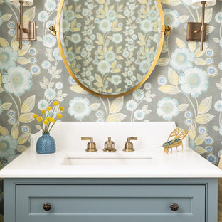Design ideas for a beach style powder room in Boston with beaded inset cabinets, blue cabinets, multi-coloured walls, an undermount sink and white benchtops.