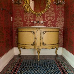 На фото: туалет среднего размера в современном стиле с зеленой плиткой, синей плиткой, красными стенами и полом из керамической плитки с
