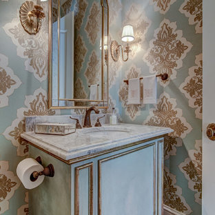 Inspiration for a medium sized classic cloakroom in Atlanta with freestanding cabinets, blue cabinets, multi-coloured tiles, multi-coloured walls, dark hardwood flooring, a submerged sink, marble worktops, brown floors and grey worktops.