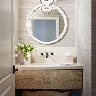 サンルイスオビスポの小さいビーチスタイルのおしゃれなトイレ・洗面所 (ヴィンテージ仕上げキャビネット、ベージュの壁、アンダーカウンター洗面器、ベージュの床、オープンシェルフ、トラバーチンの床、白い洗面カウンター) の写真