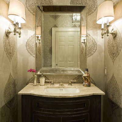 Elegant powder room photo in Philadelphia with an undermount sink and beige countertops