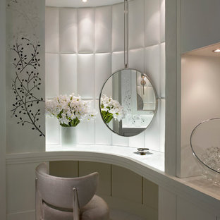 Powder room - mid-sized contemporary white tile marble floor and gray floor powder room idea in Miami with flat-panel cabinets, white cabinets, white walls and marble countertops