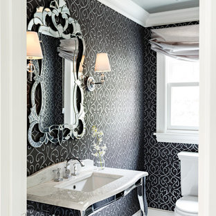 Example of a small ornate white tile mosaic tile floor powder room design in Portland with a console sink, marble countertops, a one-piece toilet and black walls