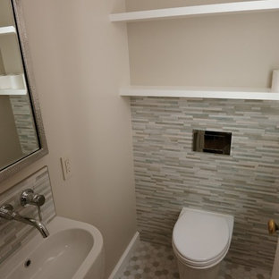This is an example of a small contemporary cloakroom in San Francisco with a wall mounted toilet, multi-coloured tiles, porcelain tiles, beige walls, porcelain flooring and a wall-mounted sink.