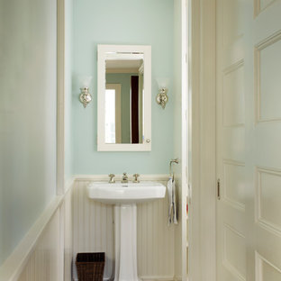 Design ideas for a medium sized classic cloakroom with blue walls, slate flooring, a pedestal sink, solid surface worktops and grey floors.