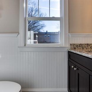 На фото: со средним бюджетом маленькие туалеты в стиле современная классика с фасадами в стиле шейкер, темными деревянными фасадами, раздельным унитазом, бежевыми стенами, полом из ламината, врезной раковиной, столешницей из гранита и коричневым полом