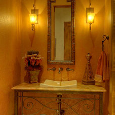 Mediterranean Powder Room by Sterling Custom Homes