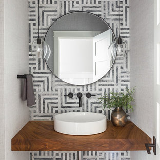Design ideas for a traditional cloakroom in Seattle with grey tiles, grey walls and a vessel sink.
