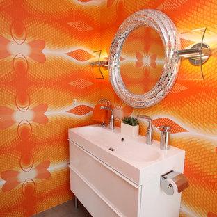 Foto di un bagno di servizio design con lavabo rettangolare e pareti arancioni