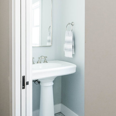 Powder room - small farmhouse marble floor and gray floor powder room idea in Portland Maine with gray walls and a pedestal sink
