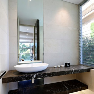 Design ideas for a contemporary powder room in Sydney with beige walls, a vessel sink and beige floor.