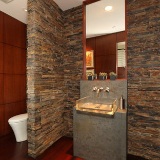 Design ideas for a contemporary cloakroom in Orange County with stone tiles, dark hardwood flooring, a vessel sink, concrete worktops, multi-coloured tiles and grey worktops.