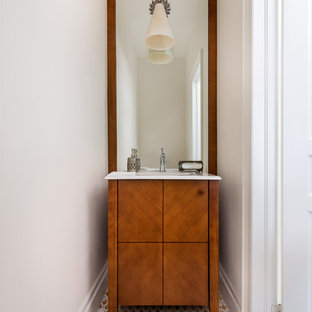 Photo of a small classic cloakroom in Toronto with an integrated sink, flat-panel cabinets, medium wood cabinets, multi-coloured tiles and marble flooring.