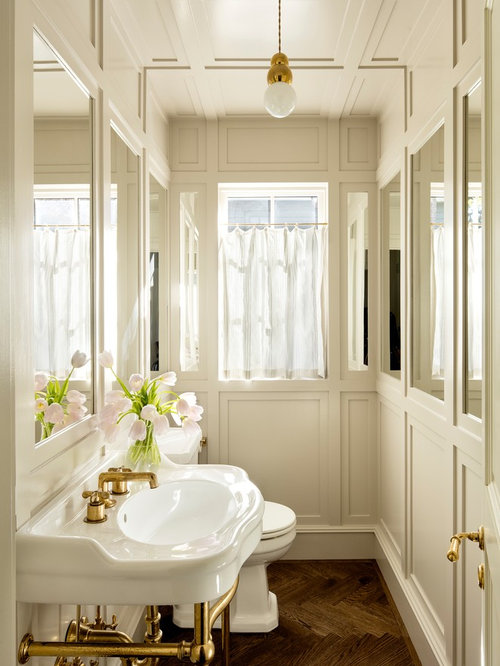 inspiration for a mid sized transitional powder room remodel in portland with white walls