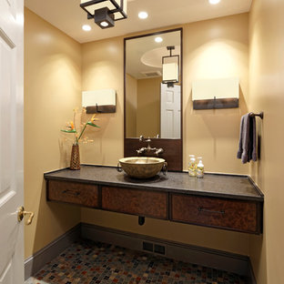 Small traditional cloakroom in DC Metro with flat-panel cabinets, multi-coloured tiles, mosaic tiles, yellow walls, mosaic tile flooring, dark wood cabinets, grey floors, a vessel sink and soapstone worktops.