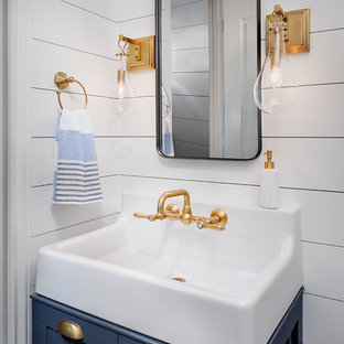 Design ideas for a small farmhouse cloakroom in San Diego with blue cabinets, white walls and ceramic flooring.