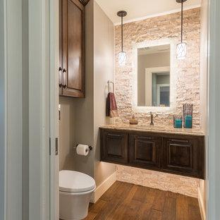 На фото: маленький туалет в стиле современная классика с фасадами с выступающей филенкой, темными деревянными фасадами, инсталляцией, бежевой плиткой, каменной плиткой, серыми стенами, паркетным полом среднего тона, врезной раковиной и столешницей из гранита с